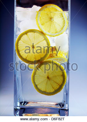 Iced water with lemon - Stock Photo