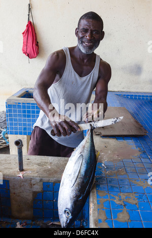 Local fishermen gutting a tuna at the fish market, Micoud, st Lucia - Stock Photo
