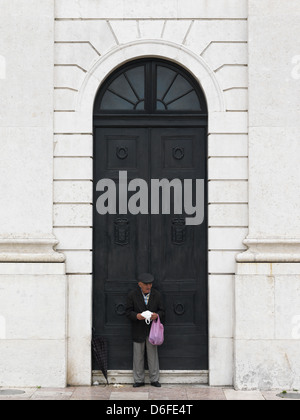Lisbon, Portugal, a man in front of the national theater Dona Maria - Stock Photo