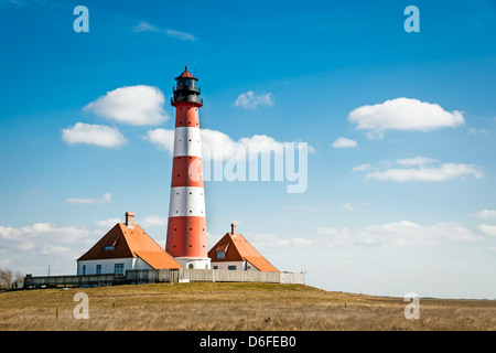 Recording in landscape from the lighthouse westerhever on a sunny day with blue sky and white clouds.