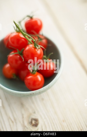 Cherry tomatoes in green bowl - Stock Photo