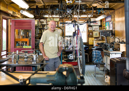 Custom bicycle frame craftsman Don MacClung photographed in his workshop along the Arkansas River in Salida, Colorado, - Stock Photo