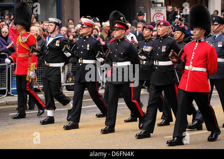 London, UK. 17th April 2013. Members of the British armed forces march in the funeral procession of Margaret Thatcher - Stock Photo