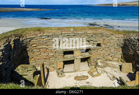 Skara Brae is a stone-built Neolithic settlement, located on the Bay of Skaill on the west coast of Mainland Orkney - Stock Photo
