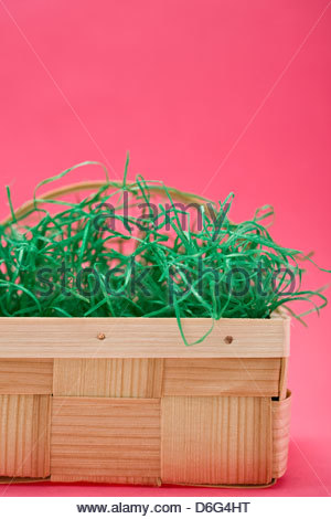Basket With Easter Eggs Full Hay
