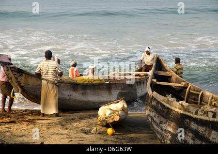 Fishermen on Varkala beach, Kerala, South India - Stock Photo