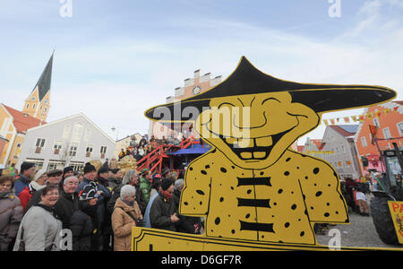 A sign with the figure of a Chinese person stands during the tradition Chinese Carnival parade in Dietfurt, Germany, - Stock Photo
