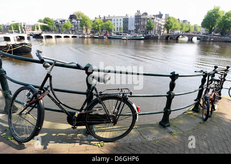 Amsterdam, The Netherlands, Holland title bicycle on a Brueckengelaender - Stock Photo
