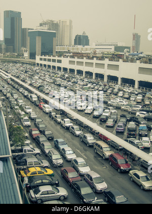 Cars parked in parking structure, Bangkok, Thailand - Stock Photo