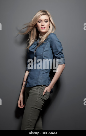 Woman wearing jeans and button up shirt - Stock Photo