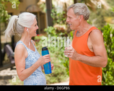 Older couple working out together - Stock Photo