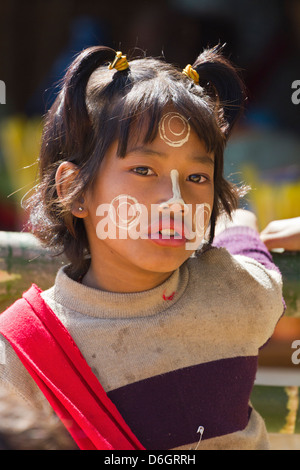 Cheeky little girl with Thanaka face decorations in Inn Thein Village, Myanmar 4 - Stock Photo