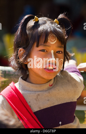 Cheeky little girl with Thanaka face decorations in Inn Thein Village, Myanmar 2 - Stock Photo