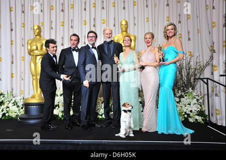 Producer Thomas Langmann (l-r), actor Jean Dujardin, director Michel Hazanavicius, actors James Cromwell, Berenice - Stock Photo