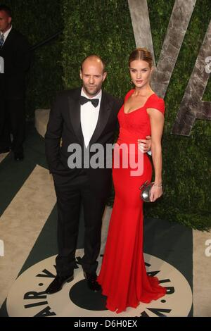 Actor Jason Statham and model Rosie Huntington-Whiteley attends the 2012 Vanity Fair Oscar Party at Sunset Tower - Stock Photo