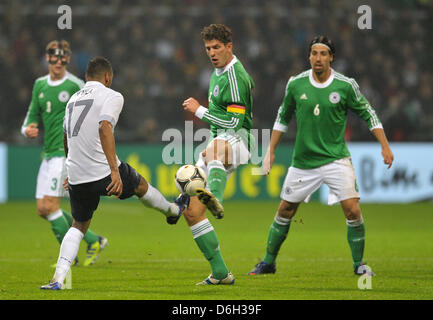 Germany's  Mario Gomez (2-R)vies for the ball with France's Yann M'Vila (2-L) next to Germany's Benedikt Hoewedes - Stock Photo