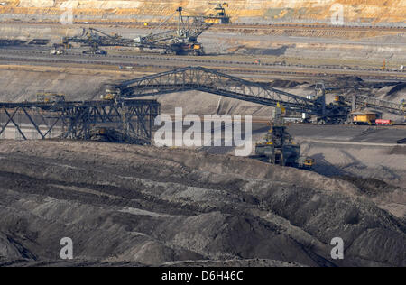Diggers excavate brown coal for the brown coal power plant Boxberg at the soft coal opencast mine Nochten of Vattenfall - Stock Photo