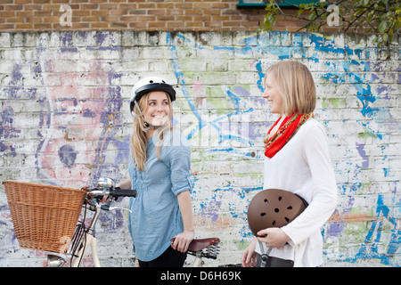 Women on bicycles on city street - Stock Photo