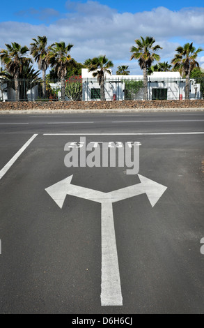 Stop T junction painted road markings, Lanzarote, Canary Islands - Stock Photo