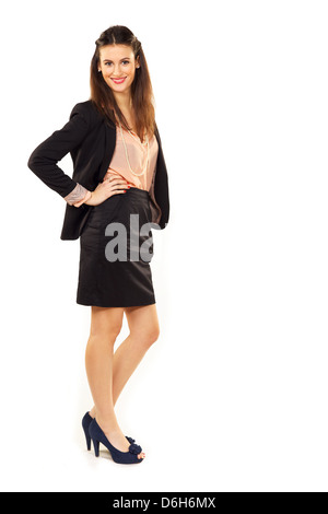 Full length portrait of a confident young businesswoman over white background - Stock Photo