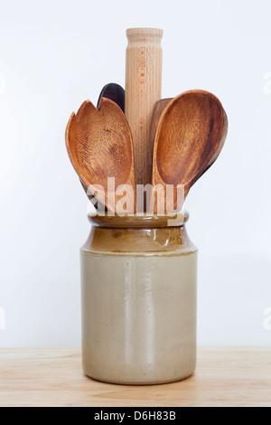 Wooden Kitchen Utensils Stored in a Traditional Stonewear Storage Jar - Stock Photo