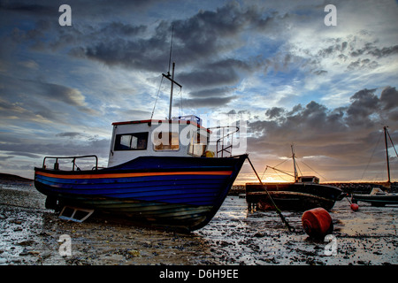 Boats at low tide in the harbor - Stock Photo