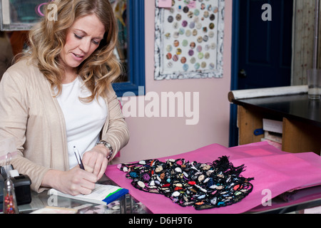 Cashier working in thrift store - Stock Photo