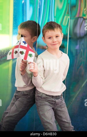 Boy waving a flag of Montreal in Palais des Congrès de Montreal Congress Hall in downtown - Stock Photo