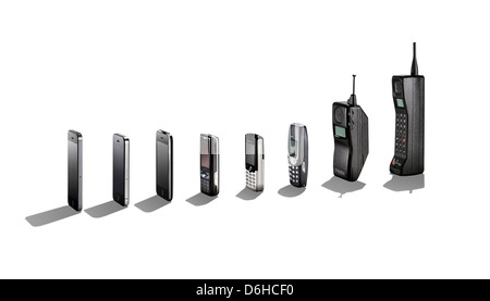 A range of mobile phones showing their evolution with shadows. - Stock Photo