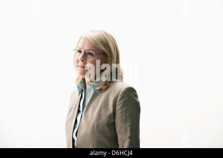 Portrait of mature businesswoman wearing glasses - Stock Photo