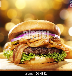 gourmet bacon hamburger with golden background - Stock Photo