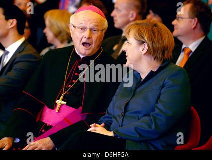 Berlin, Germany. 18th April, 2013. Archbishop Robert Zollitsch sits with GermanChancellor Angela Merkel during - Stock Photo
