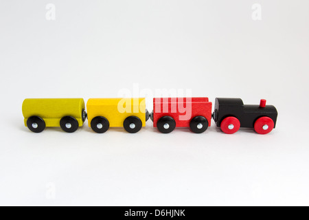 Wooden toy train on white background - Stock Photo