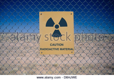 Sign warning radiation risk Nevada Test Site USA - Stock Photo