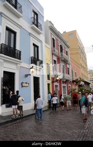 Colorful buildings and cobblestone street in Old San Juan, Puerto Rico - Stock Photo