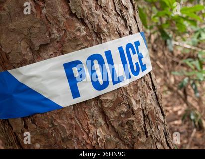 police scene of crime  tape - Stock Photo