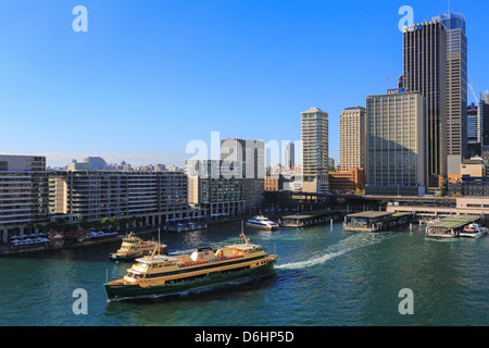 Sydney Harbour and Circular Quay ferry traffic on a sunny day. - Stock Photo