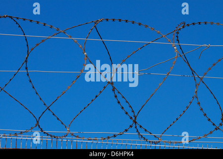 Barbed wire fence, Robben Island, Table Bay, Cape Town, South Africa - Stock Photo