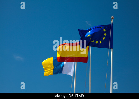 Flags of Spain, European Union, and the Canary Islands - Stock Photo