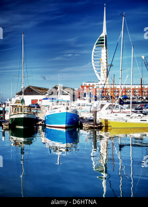 Boats berthed at Camber docks in Portsmouth Hampshire, with the Spinnaker Tower standing tall in the background - Stock Photo