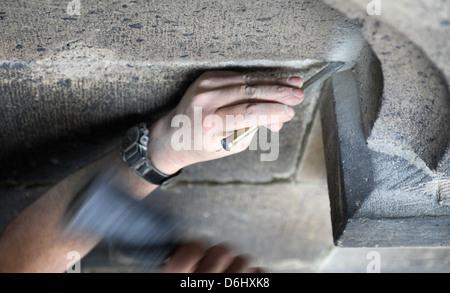 Berlin, Germany, a stonemason at work with tools - Stock Photo