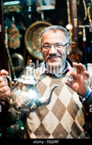 Moroccan teapot vendor in Marrakech souk and market, Morocco, North Africa, Africa - Stock Photo