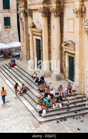 Tourists on the steps of Dubrovnik Cathedral (Cathedral of the Assumption of the Virgin Mary), Dubrovnik, Croatia, - Stock Photo