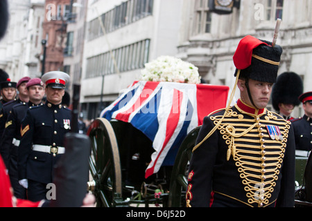 Coffin of Baroness Margaret Thatcher on gun carriage being escorted by members of armed services, on way to St Pauls - Stock Photo