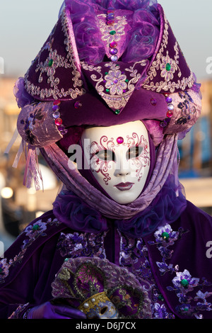 Masks at Venice Carnival in St. Mark's Square, Venice, Veneto, Italy, Europe - Stock Photo