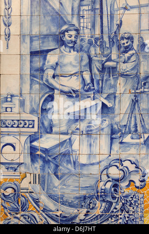 A blacksmith's workshop depicted on traditional Portuguese Azulejo tiles on a building in Alfama, Lisbon, Portugal, - Stock Photo