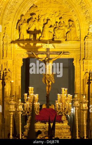 Semana Santa (Holy Week) float outside Seville Cathedral, Seville, Andalucia, Spain, Europe - Stock Photo