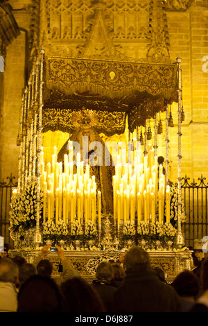 Semana Santa (Holy Week) float (pasos) with image of Virgin Mary outside Seville cathedral, Seville, Andalucia, - Stock Photo