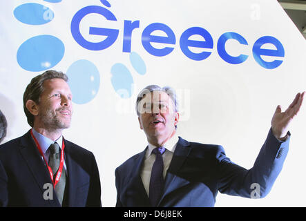 Governing mayor of Berlin Klaus Wowereit (SPD, R) is greetd by Greek Minister of Tourism Pavlos Yeroulanos during - Stock Photo