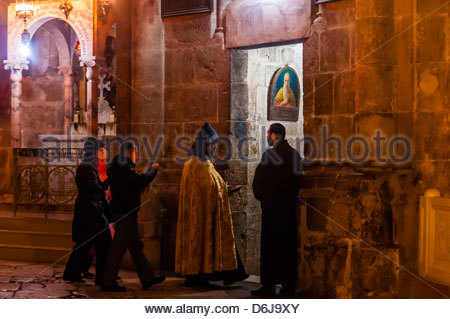 An Armenian Orthodox mass, Church of the Holy Sepulchre (site of the last five stations of the Cross and venerated - Stock Photo